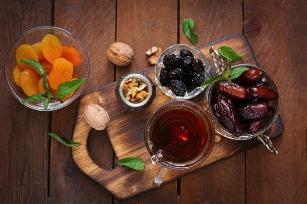 mix-dried-fruits-date-palm-fruits-prunes-dried-apricots-raisins-and-nuts-and-traditional-arabic-tea-ramadan-ramazan-food-top-view_2829-318